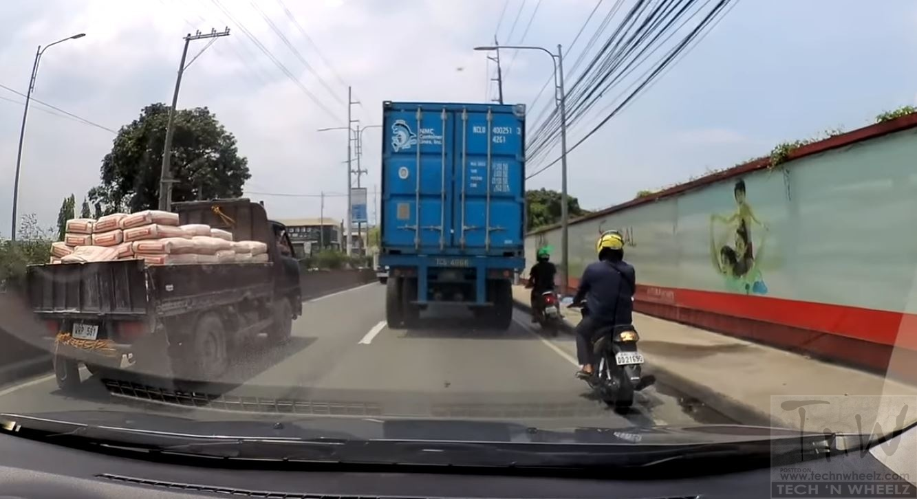 Helmet saves rider's life as heavy truck runs over his head